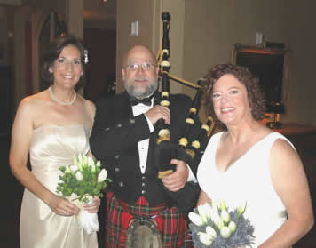 Chris plays bagpipes for this lovely wedding